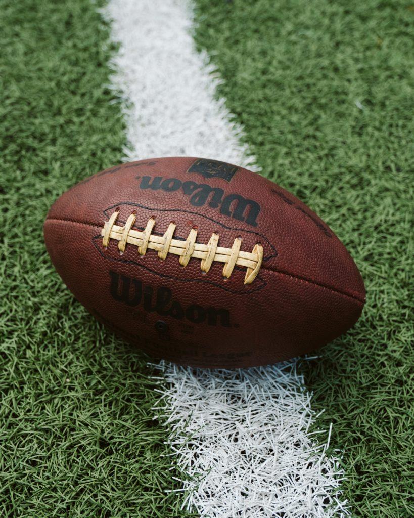 brown Wilson American football on grass